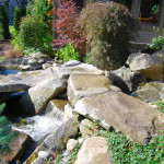 Rock waterfall in the front of the house
