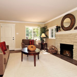 Light and bright entry into the living room warmed by the stone fireplace